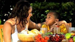 stock-footage-young-ethnic-mother-son-healthy-eating-lunch
